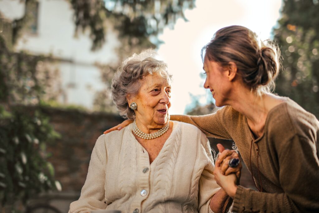 woman and old woman smiling